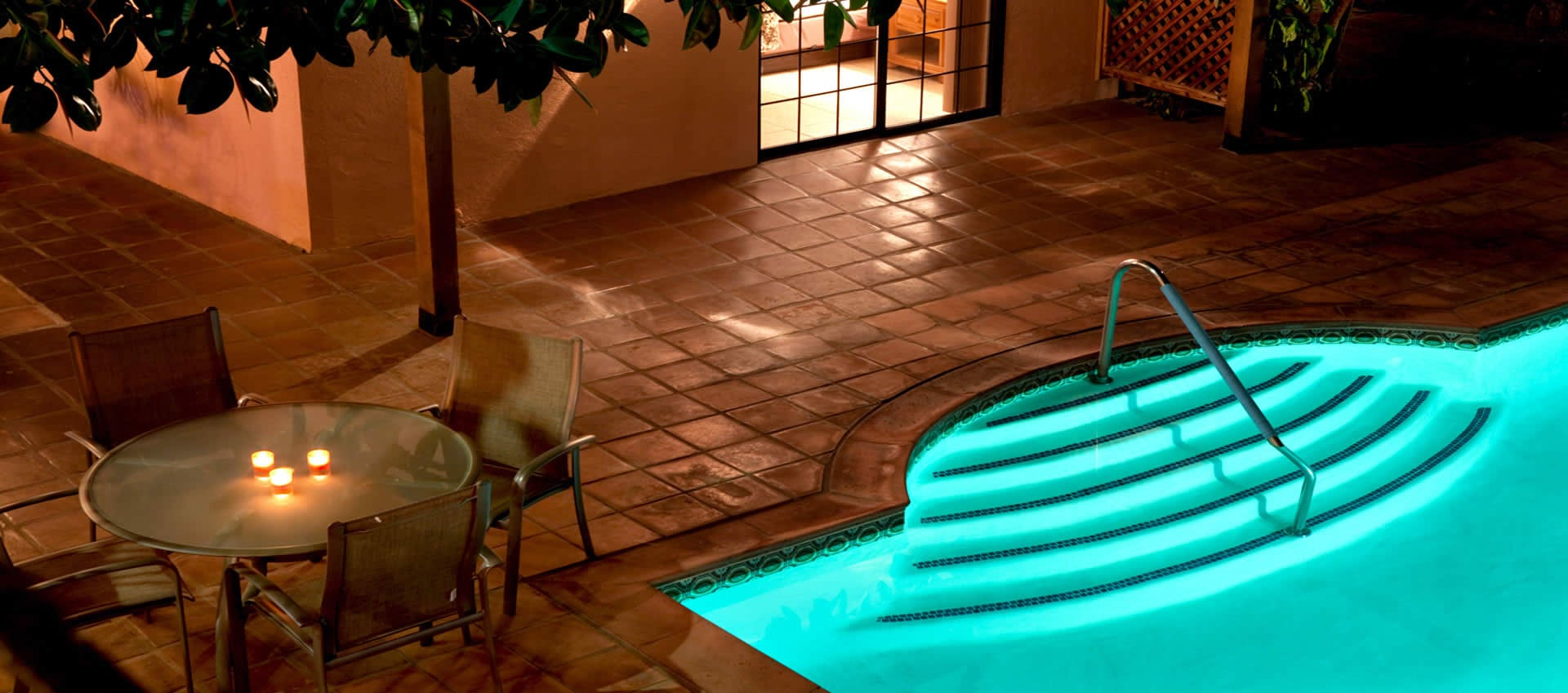 Hotel California night lit patio and pool