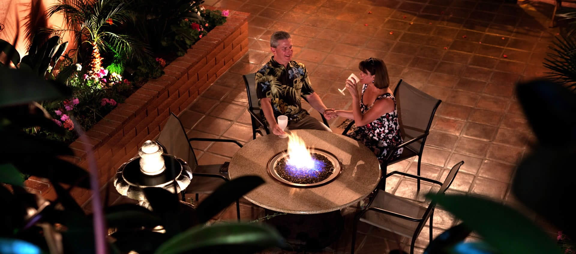 Patio fire ring with guests enjoying drinks